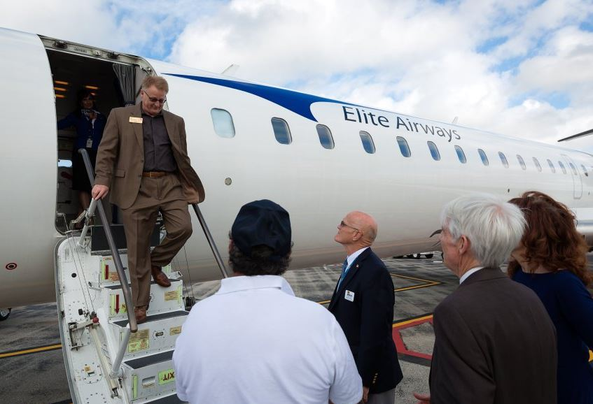 Russell Tuff, a candidate for Collier County Commission, exits a Bombardier CRJ-700 jet while touring the aircraft with other attendees of a press conference announcing details about new commercial flights at the Naples airport with Elite Airways on Wednesday, Feb. 3, 2016, in Naples. The airline's president announced Wednesday that Elite Airways commercial flights would commence Feb. 27 from the Naples Municipal Airport to Newark, Portland, Maine, Melbourne and Vero Beach. (David Albers/Staff) - Image credit: David Albers